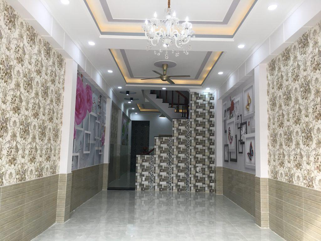 Phòng khách nhà phường dĩ an 64m đối diện chợ xóm mới kinh doanh buôn bán